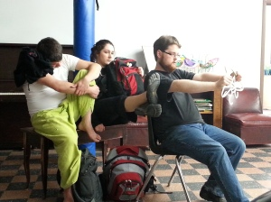 Chris, Emma, and Charlie improvising a scene.